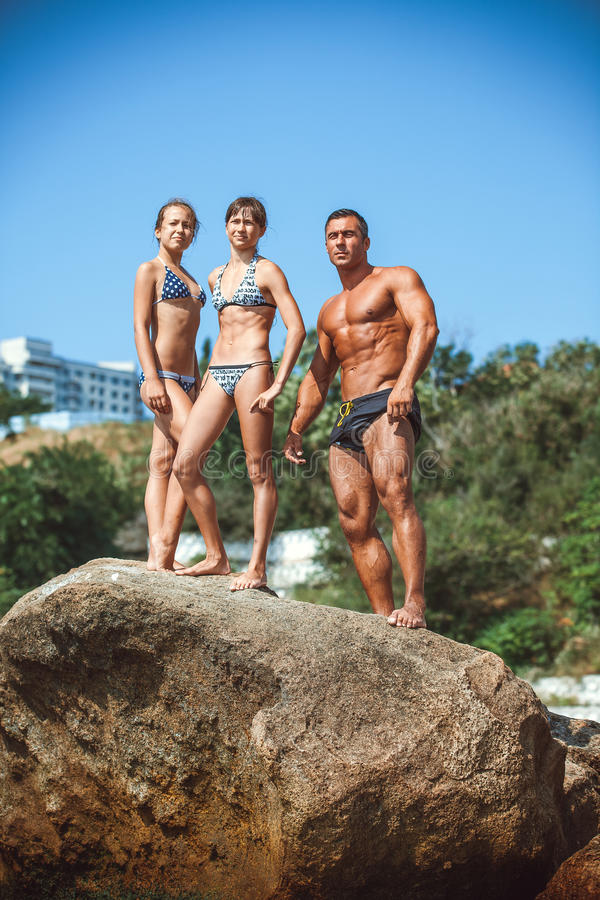Teacher on fitness with the pupils on a beach royalty free stock image