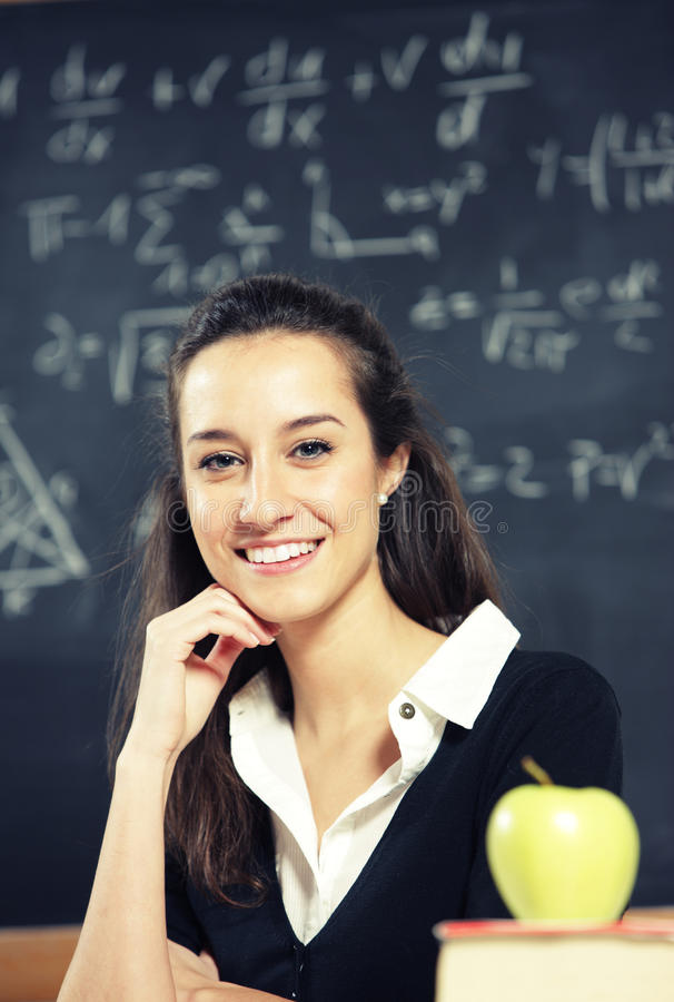 Teacher in front of a blackboard royalty free stock photos