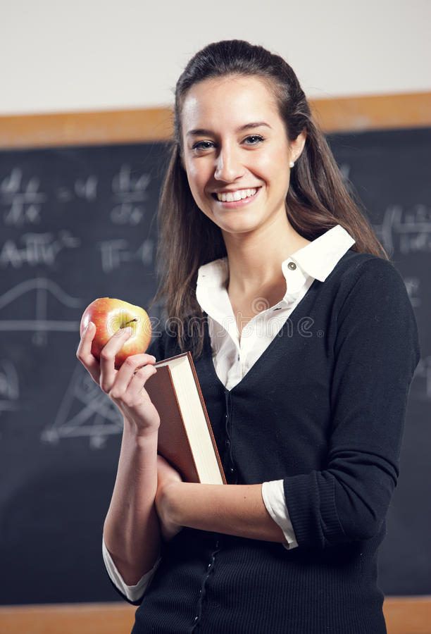Teacher in front of a blackboard royalty free stock images