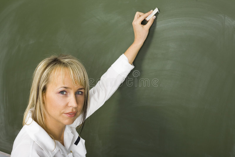 Teacher at greenboard royalty free stock photography