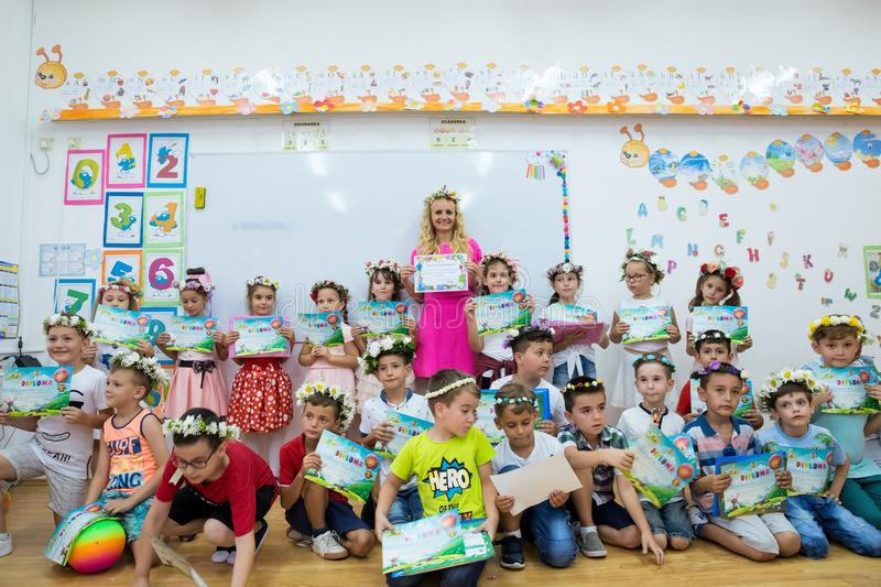 Teacher with a group of first graders children on the last day of school stock photography