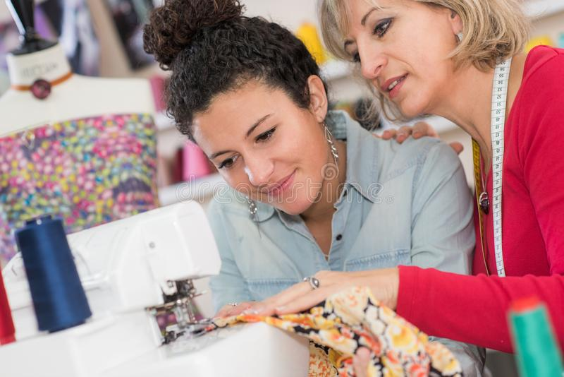 Teacher helping fashion student stock photography