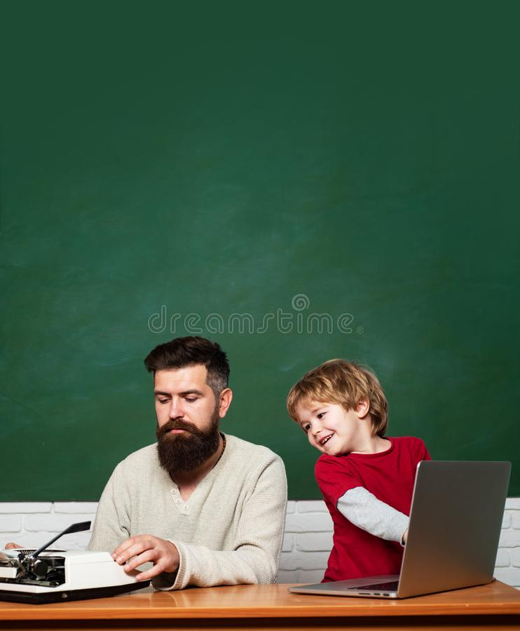 Teacher helping kids with their homework in classroom at school. Child learning. Homeschooling. First day in school royalty free stock photography