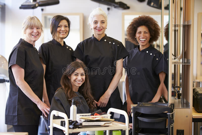 Teacher Helping Mature Students In Hairdressing royalty free stock photography