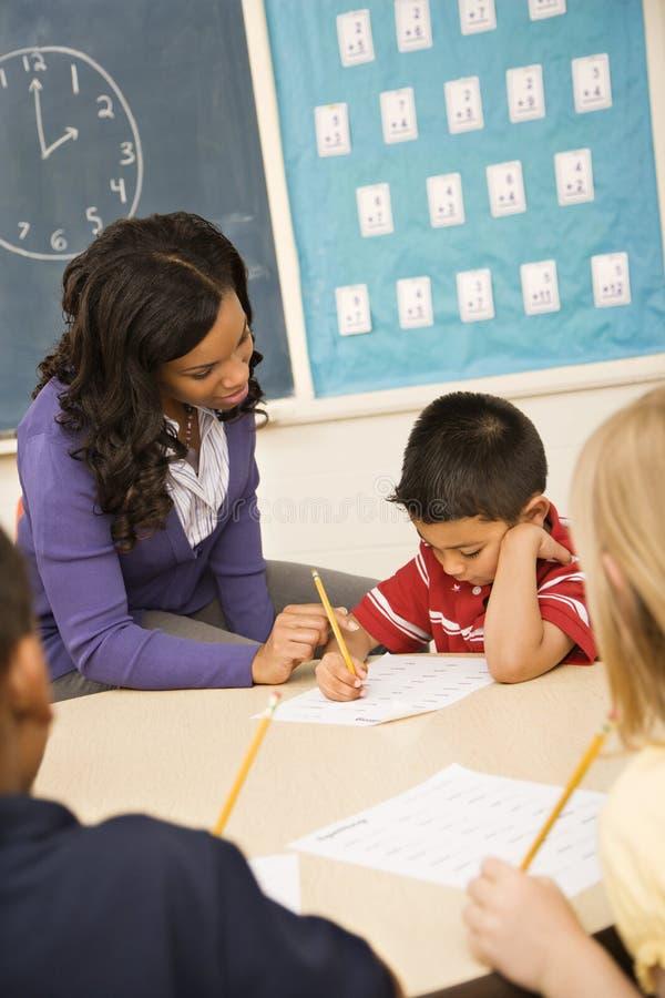 Teacher Helping Student Stock Photography
