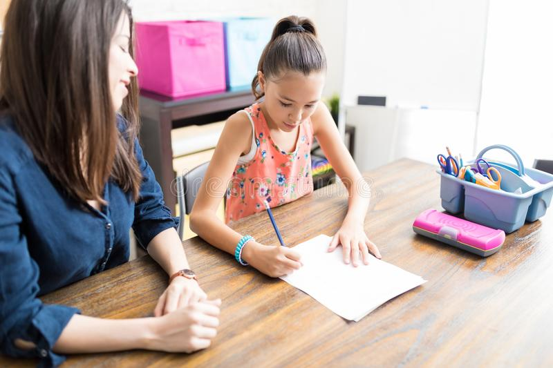 Teacher Helping Student In Schoolwork At Home stock image
