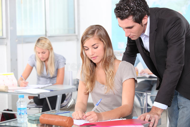 Teacher helping students. In the classroom royalty free stock photo
