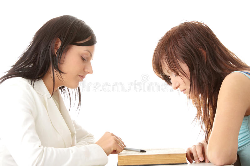 Teacher Helping teen Student royalty free stock photo