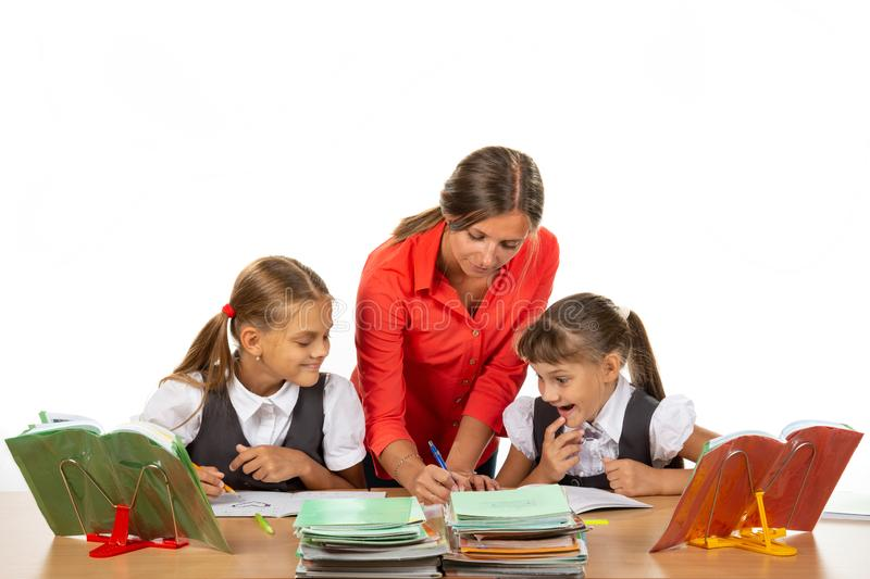 Teacher Helps Students Solve an Example. Teacher  Helps Students Solve an Example stock photo