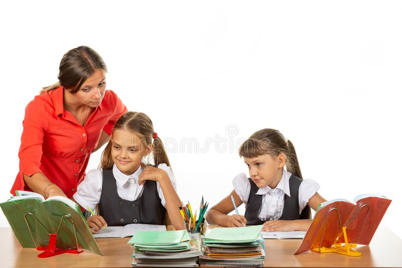 The teacher helps to understand the task of the student stock photos