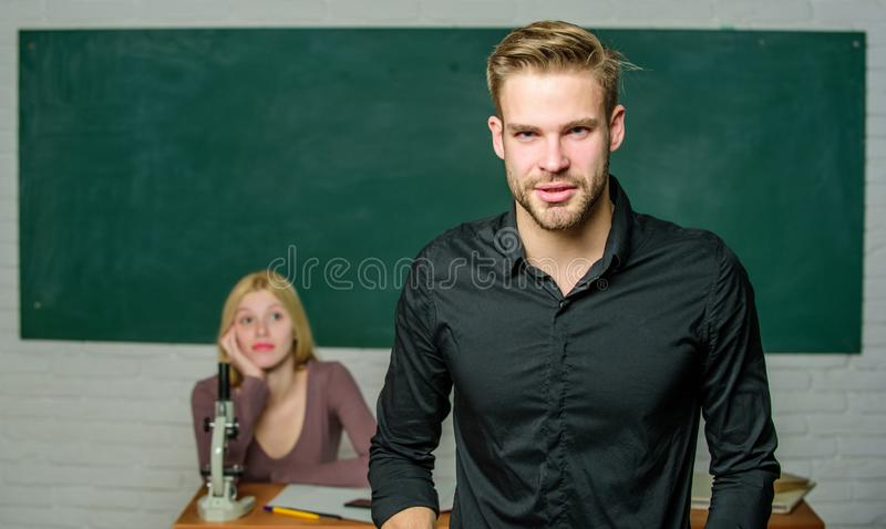 Teacher of her dreams. Handsome teacher. School and college education. Successfully graduated. Youth mentoring. Man well. Groomed attractive teacher in front of royalty free stock image