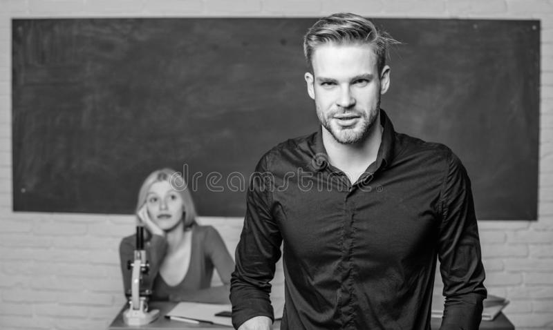 Teacher of her dreams. Handsome teacher. School and college education. Successfully graduated. Youth mentoring. Man well. Groomed attractive teacher in front of royalty free stock images