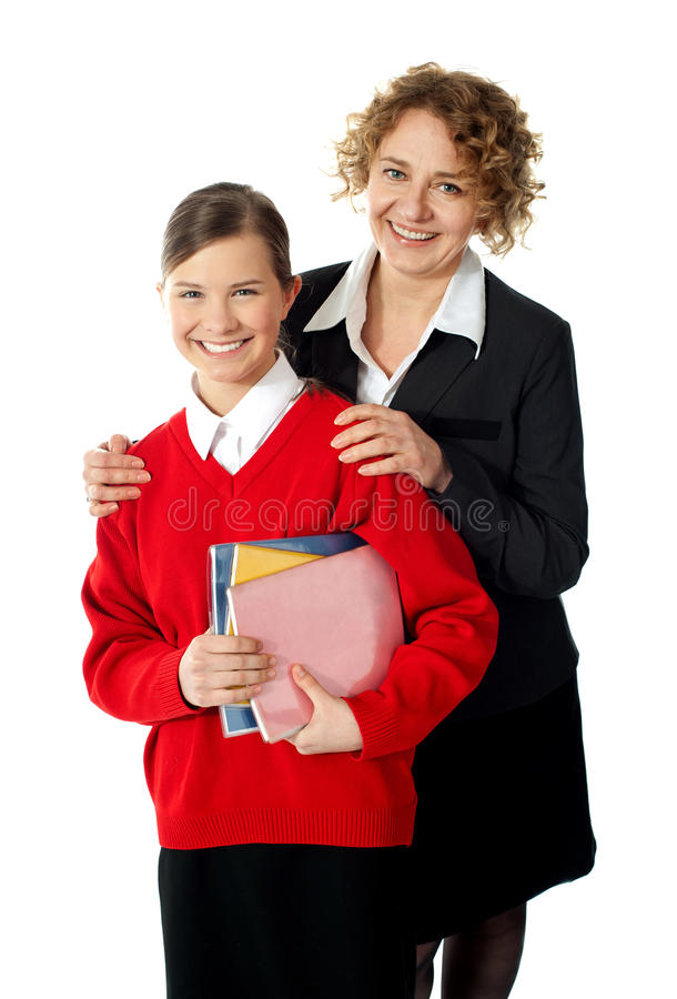 Teacher with her student, posing. Teacher with her student. Shot in studio over white stock photo