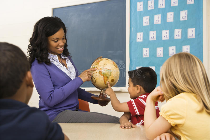 Teacher Holding Globe royalty free stock image