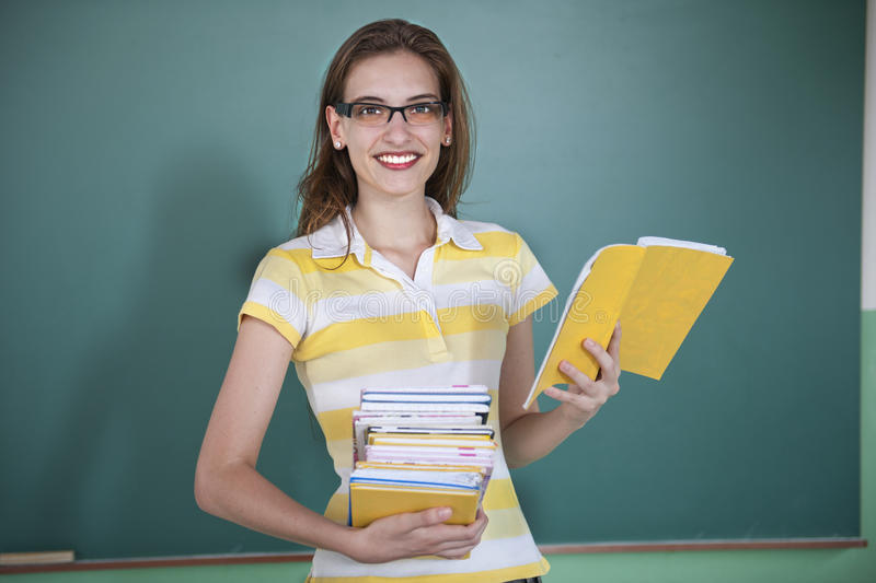 Teacher infront of blackboard royalty free stock photos