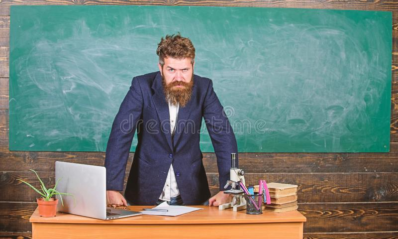 Teacher interesting interlocutor as authority. Teacher bearded man tell scary story. Talking to students or pupils. Teacher charismatic hipster stand near stock images