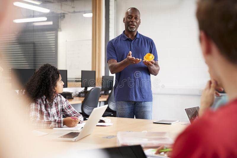 Teacher In Lesson For College Students Studying CAD/3D Design stock image