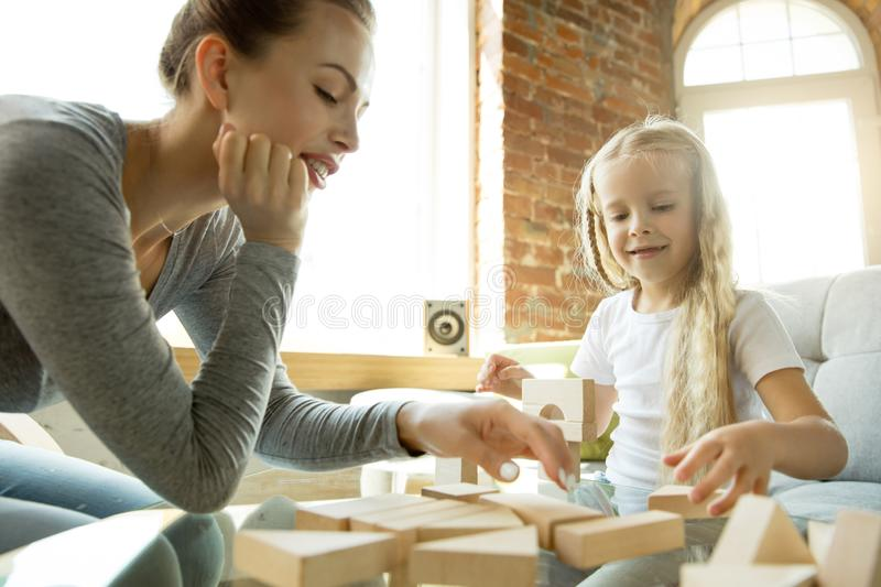 Teacher and little girl, or mom and daughter. Homeschooling concept royalty free stock photo