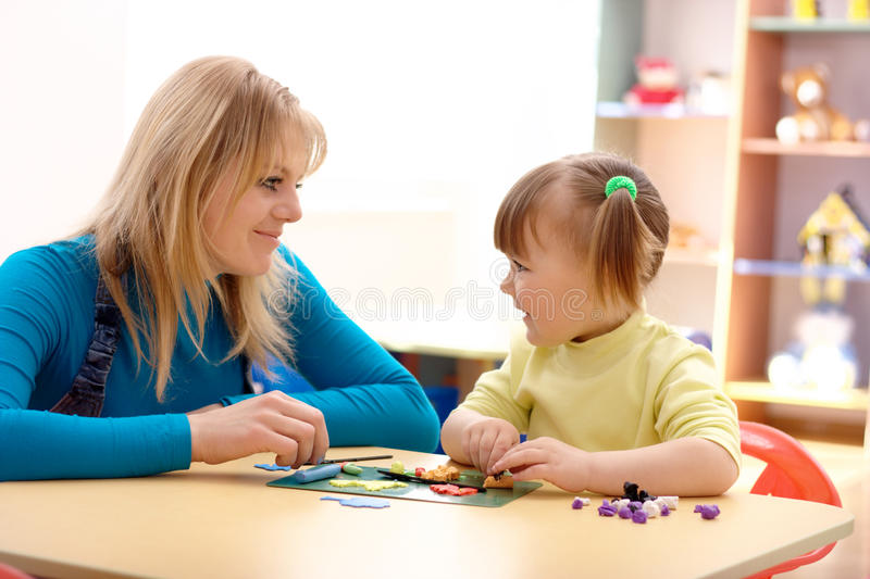 Download Teacher And Little Girl Play With Plasticine Stock Photo - Image: 14114688