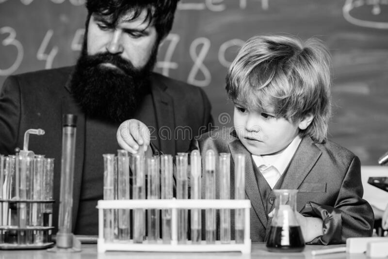 Teacher man with little boy. Biology Science lab. father and son at school. learning chemistry in school laboratory royalty free stock image