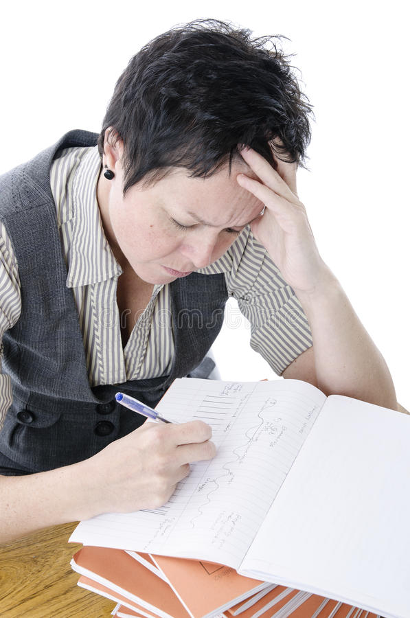 Teacher marking work royalty free stock image