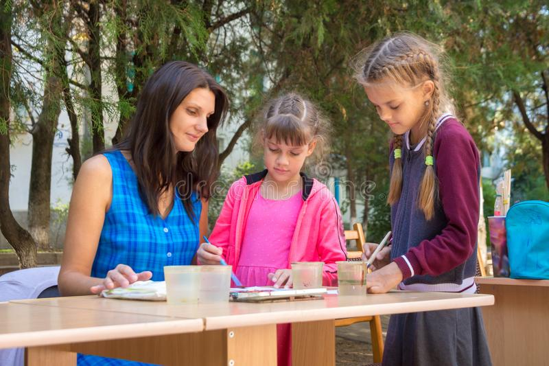 The teacher at the master class gives drawing lessons stock photo