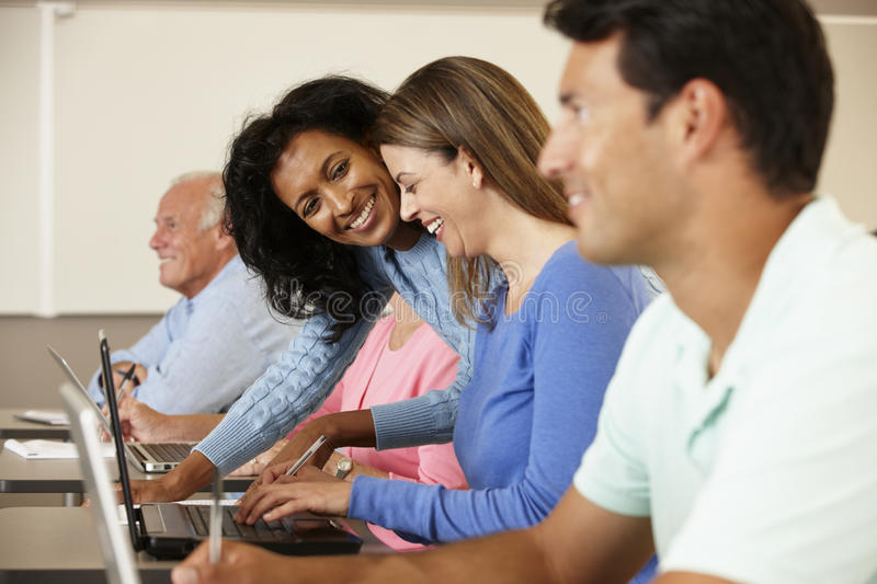 Teacher and mature students in class stock photography