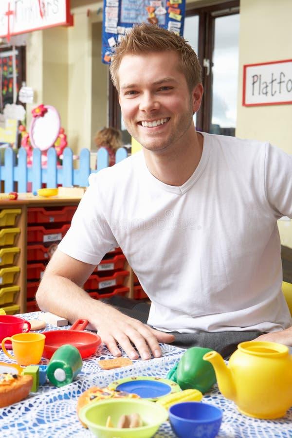 Teacher in nursery school royalty free stock images