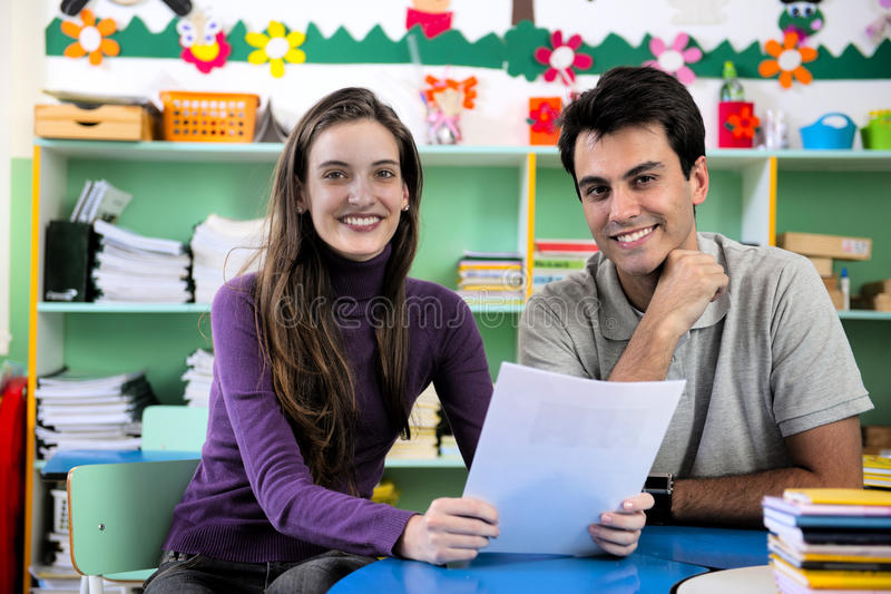 Teacher and parent in classroom stock images