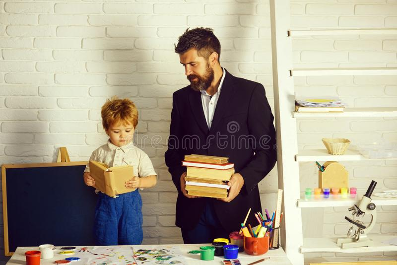 Teacher and preschooler. Books and reading. Education and tales. royalty free stock photography