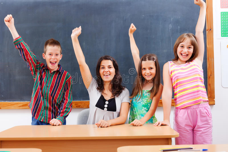 Teacher and pupils in classroom royalty free stock images