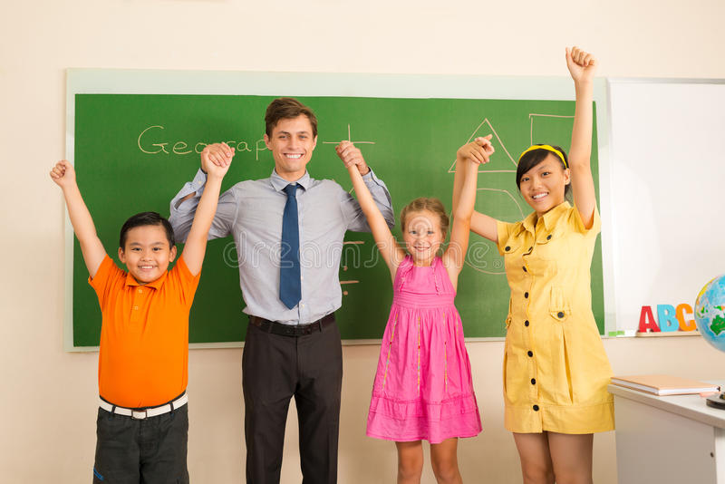 Teacher and pupils royalty free stock image