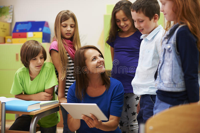 Teacher with pupils royalty free stock photo
