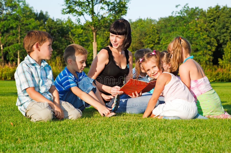 Download Teacher reading to kids stock image. Image of elementary - 15609363