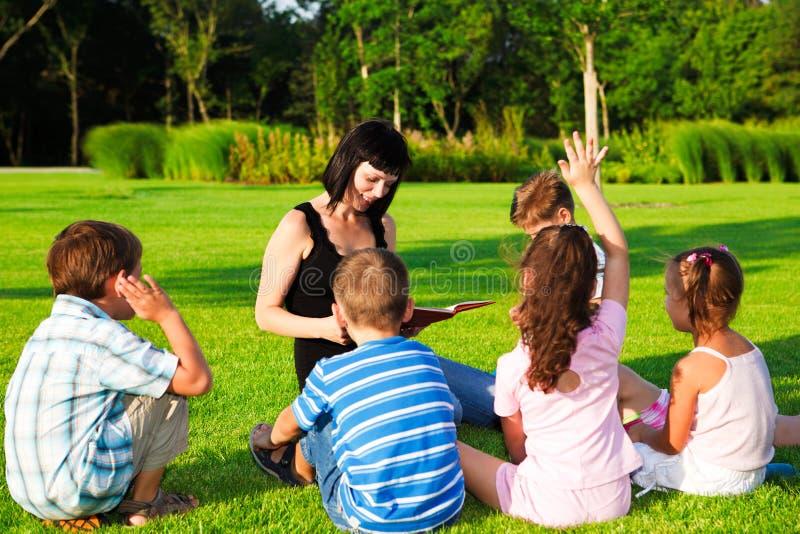 Download Teacher reading to kids stock image. Image of joyful - 19360063