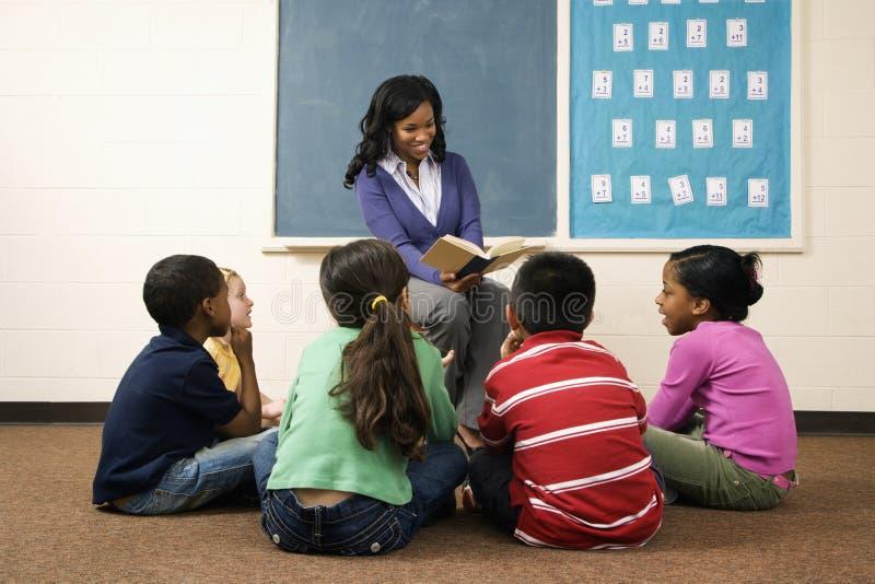 Teacher Reading to Students stock photos
