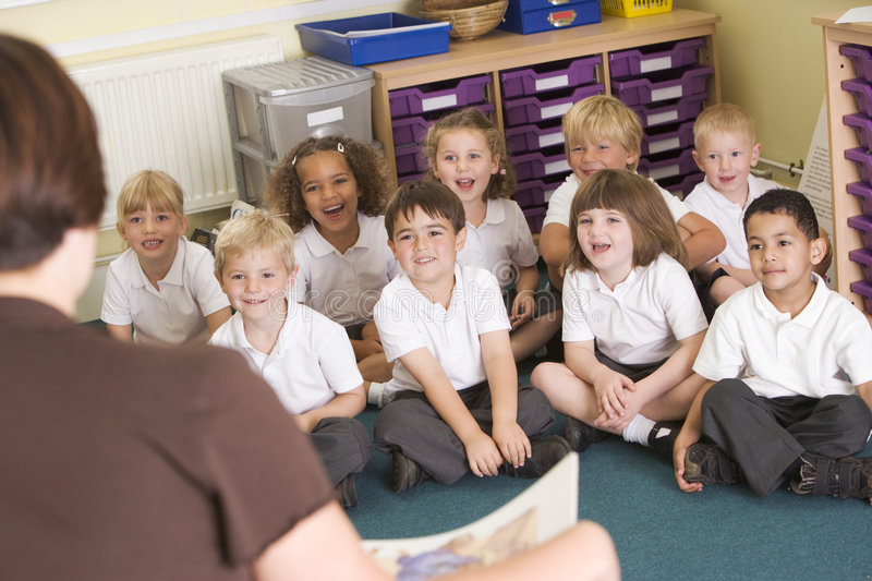 A Teacher Reads To Schoolchildren In A Class Royalty Free Stock Images