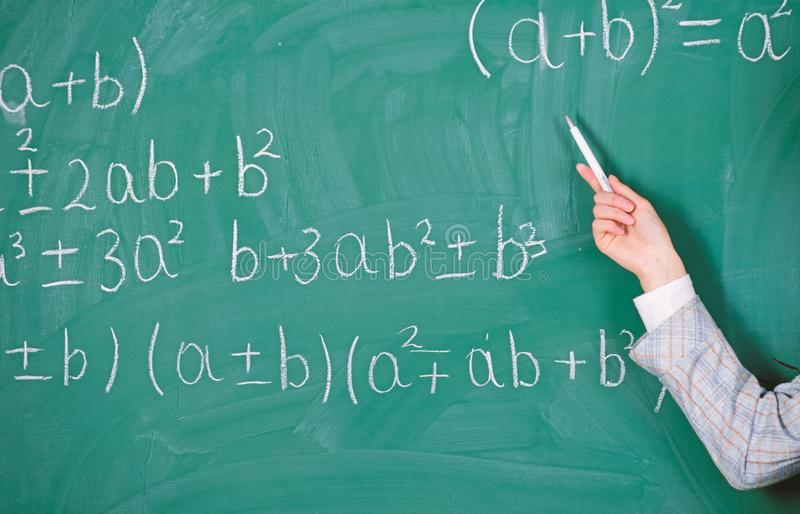 Teacher on school lesson at blackboard. Back to school. Teachers day. Study and education. Modern school. Knowledge day. School. Home schooling. woman hand in royalty free stock photo