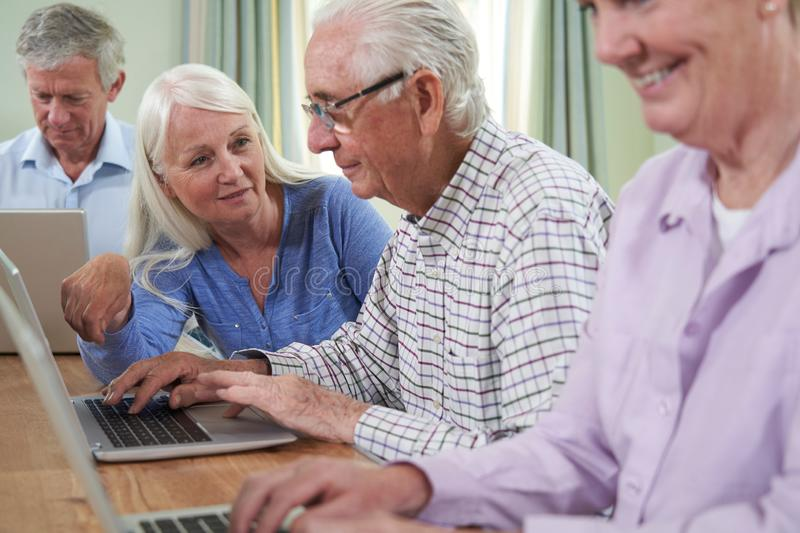 Teacher With Senior Students In Computing Adult Education Class royalty free stock photography