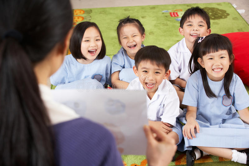 Teacher Showing Painting To Chinese Students. Teacher Showing Painting To Students In Chinese School Classroom stock photography