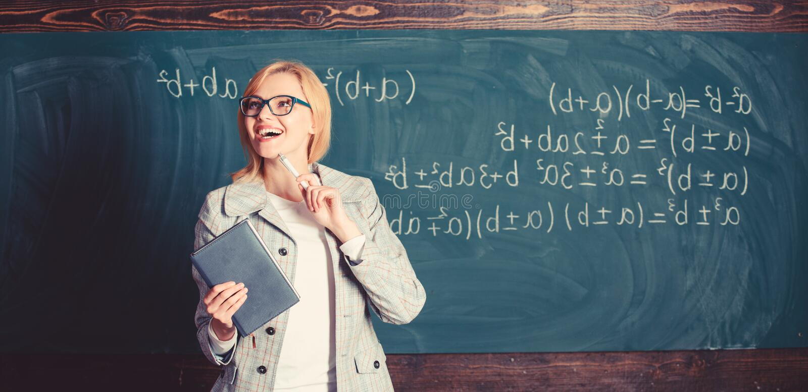Teacher smart woman with book explain topic near chalkboard. What makes great teacher. School teacher explain things stock photos