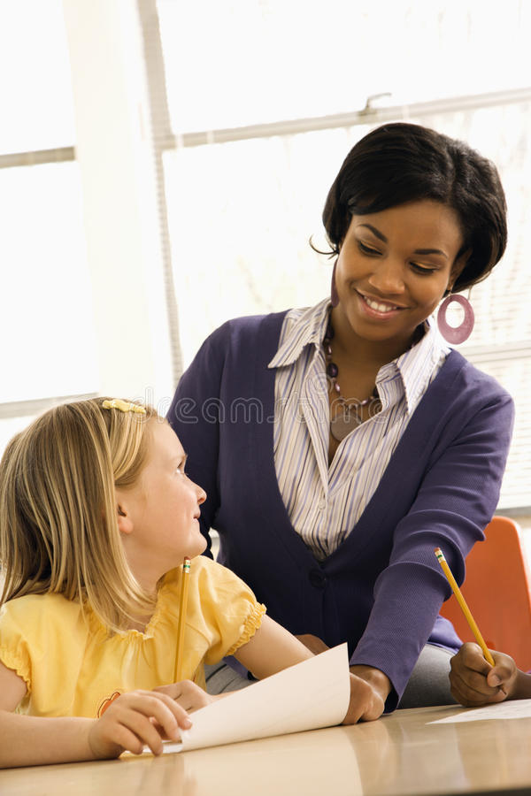 Free Teacher Smiling And Helping Student Royalty Free Stock Photos - 12536008