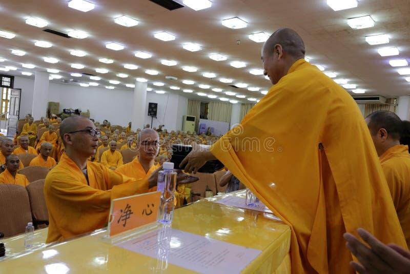 Teacher of south fujian buddhist college give diplomas to the graduates. Dean of south fujian buddhist college hold graduation ceremony, amoy city, china. 2015.6 stock photo