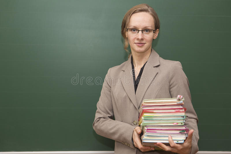 Teacher With Stack Of Books Royalty Free Stock Photos