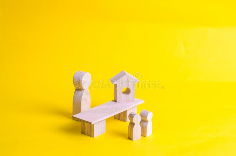 The teacher is standing at the table and talking to the children. Concept of education, lessons of work. The process of teaching c royalty free stock image