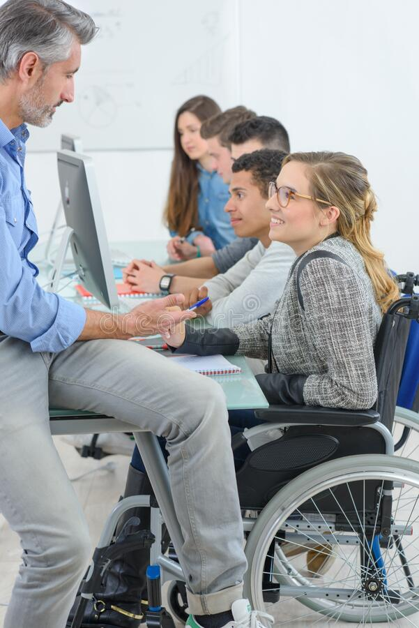 Teacher with studants one disabled royalty free stock photo