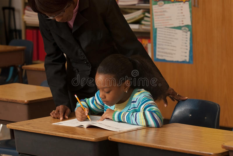 Teacher an student stock photos