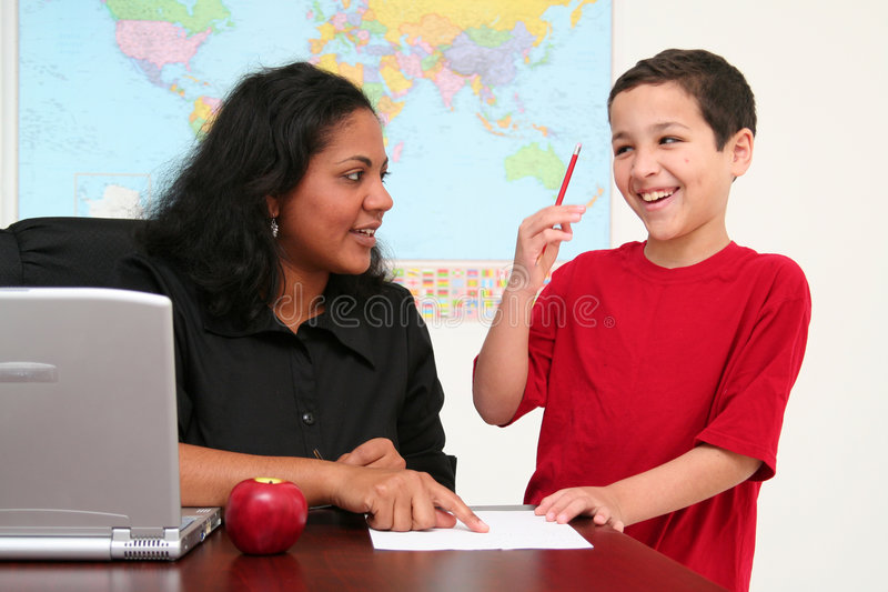Download Teacher and Student stock image. Image of caucasian, schoolwork - 5094113