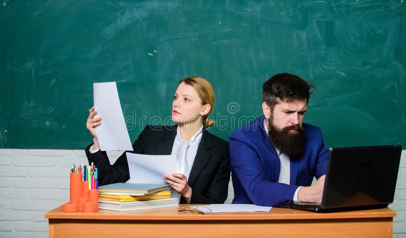 Teacher and student on exam. back to school. Formal education. businessman and secretary. paper work. office life royalty free stock images