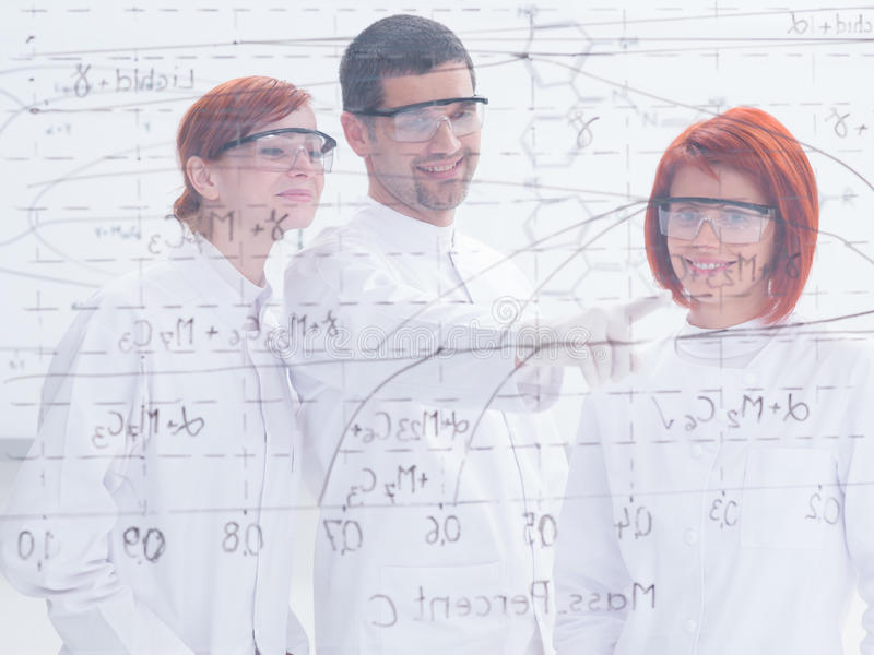 Download Teacher and student in lab stock image. Image of model - 31258791
